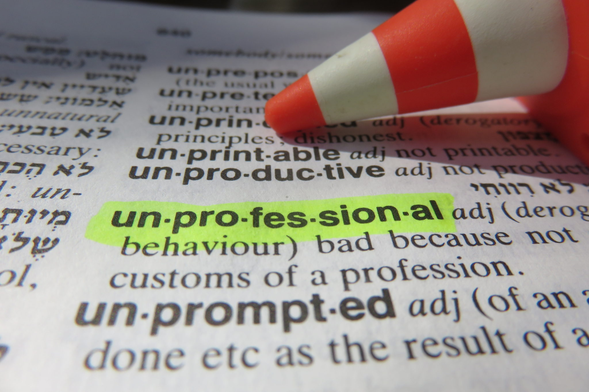 The word 'unprofessional' highlighted