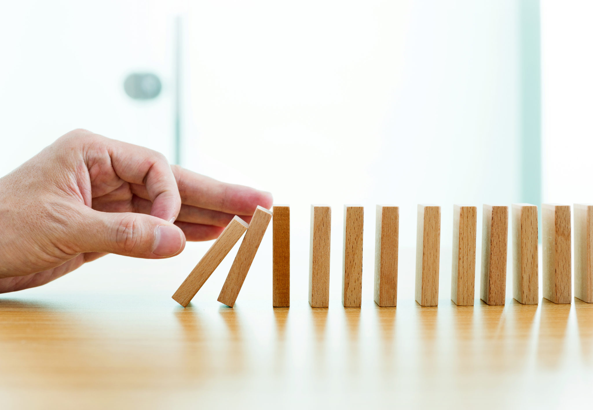Man hand pushing domino pieces