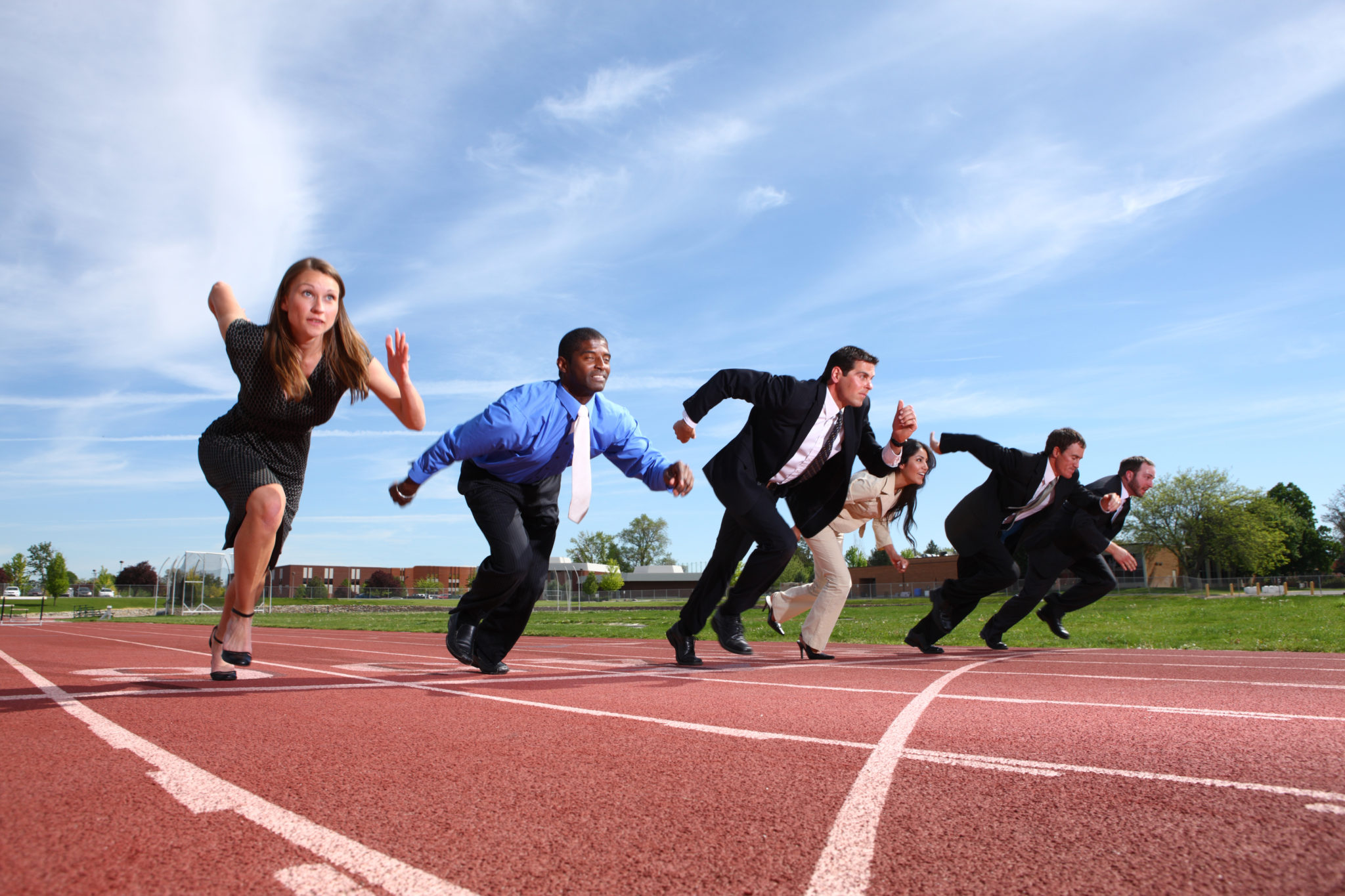 Business people starting a running race