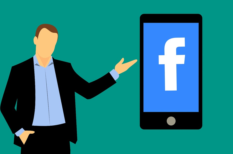 Cartoon man in suit points to enlarged phone with Facebook logo