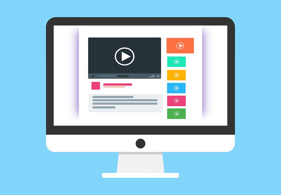 Cartoon desktop computer showing YouTube videos