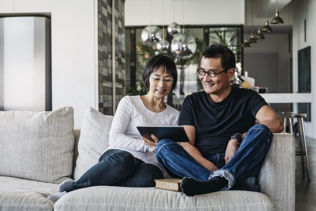 Man and woman watching a video on a tablet