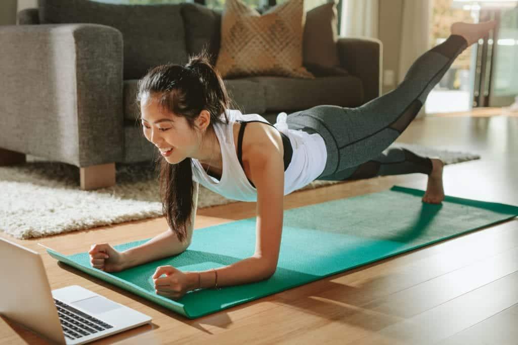 Girl doing virtual workout class